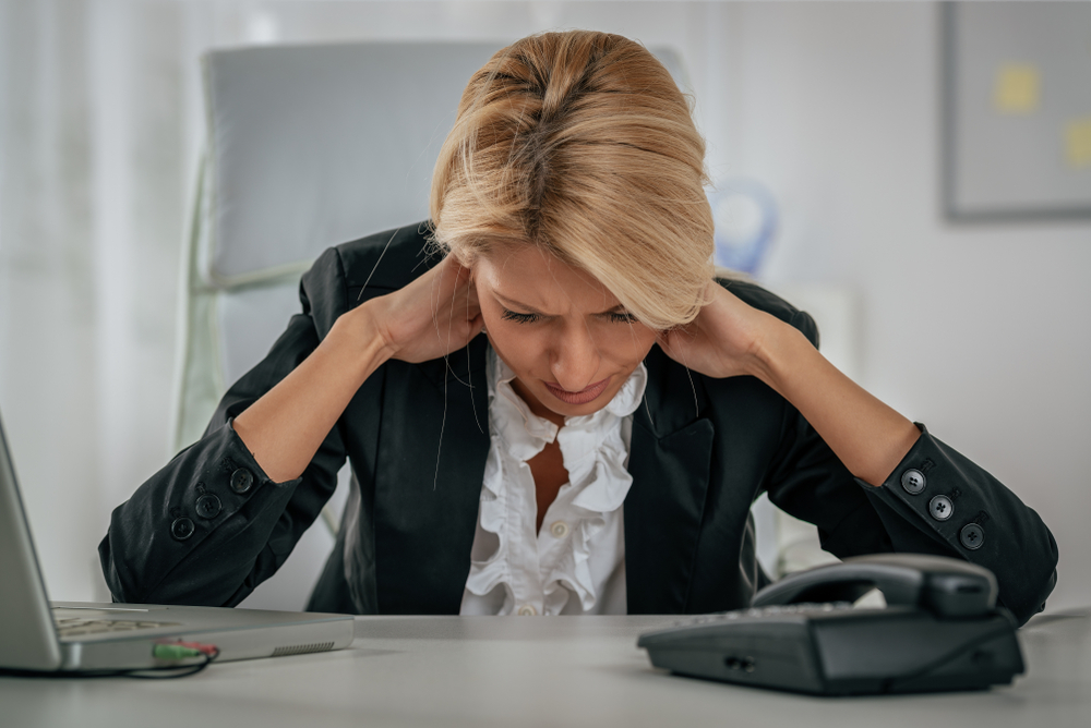 image of a Young tired businesswoman with neck pain