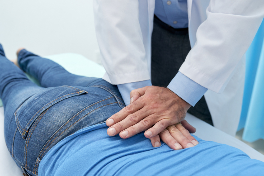 image of a Chiropractor doing pushing motion to adjust back