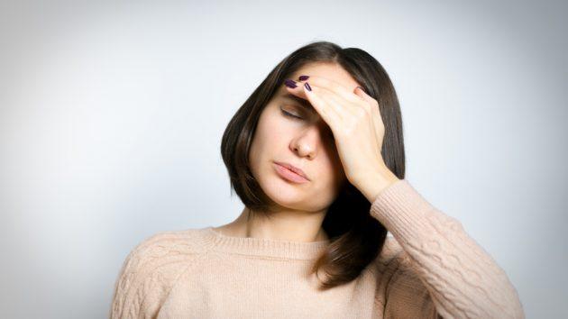 image oa a beautiful woman has headache and injury