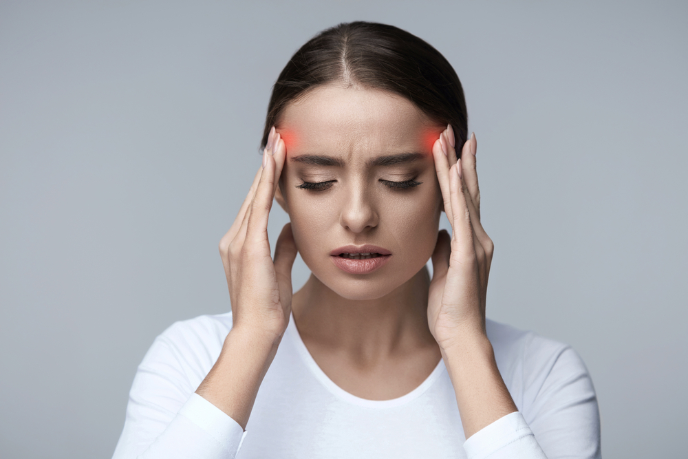Image of a Beautiful Young Woman Feeling Strong Head Pain