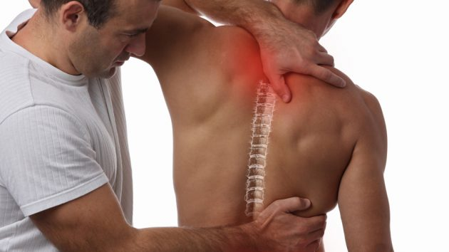 image of a Man having chiropractic back adjustment