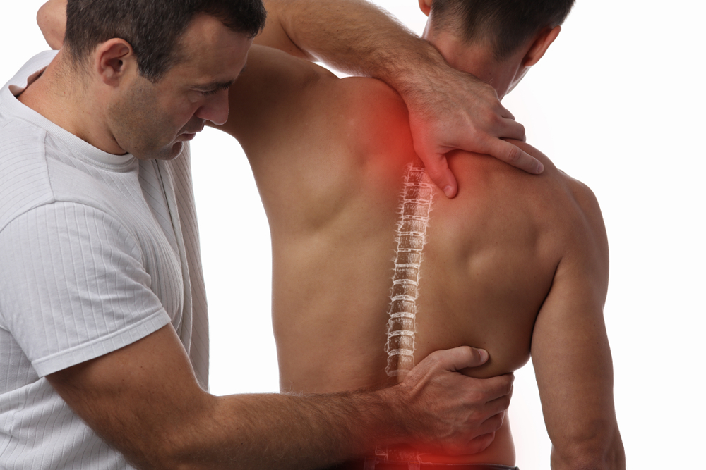 image of a Man having chiropractic back adjustment