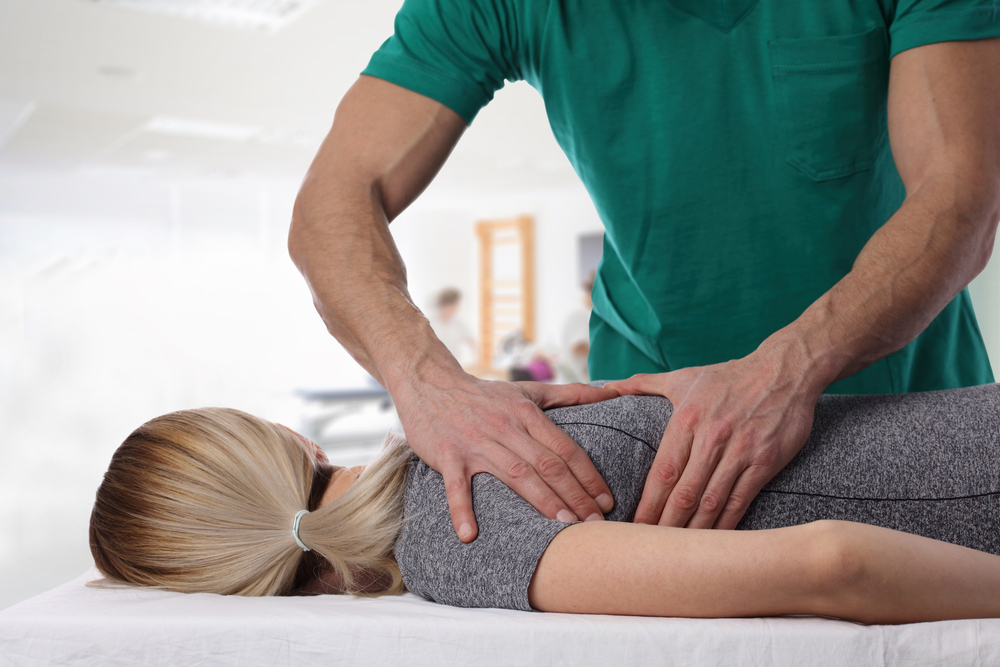 image of a Woman having chiropractic back adjustment