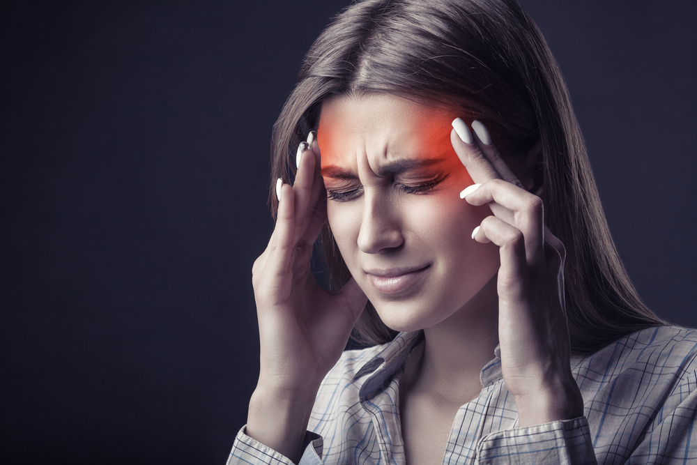 image of a Young woman is suffering from a headache