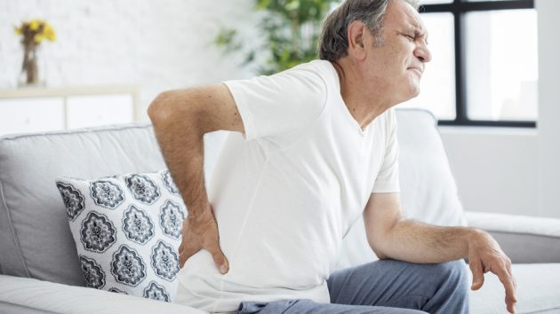Image of an Old man with back pain
