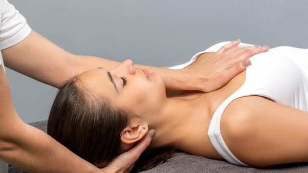 Close up of female patient receiving osteopathic neck treatment, image by city osteopathy